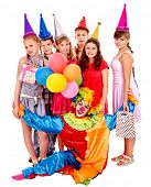 Birthday party group of teen people with clown isolated. In the role of animator girl