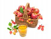 Ripe Apples In A Wicker Basket And A Glass Of Juice Isolated On White Background