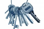 Bunch of steel house keys on plain background