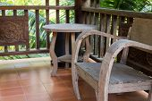 Wooden Desk And Chair On The Balcony