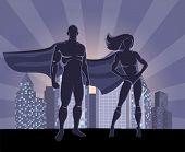 Superhero and female superhero silhouettes