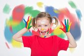 Little Girl In Front Of A Coloured Vortex Boasting Her Vitality