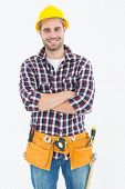 Portrait of confident male handyman wearing tool belt on white background