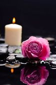Beautiful rose with candle and therapy stones,Valentines Day background