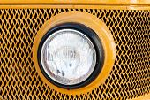 Old Car (bus) Headlight. Retro Style. Yellow.