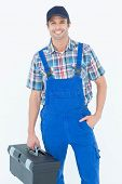 picture of plumber  - Portrait of confident plumber carrying tool box over white background - JPG