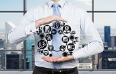 Businessman Holding Business Icon