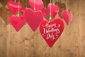 Happy valentines day against wooden planks