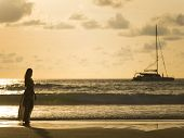 Silhouette of a young woman on the beach in Thailand
