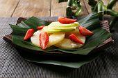 Fruit dessert on green leaf on table