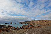 Lundadrangur Rock Arch In Dyrholaey, Iceland