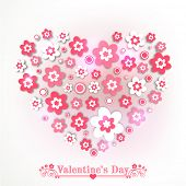 Love card design with heart shape made by flowers on grey background for Happy Valentines Day celebration.