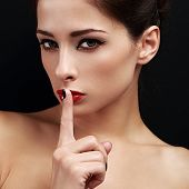 Beautiful Makeup Woman Showing Secret Sign The Finger Near Lips