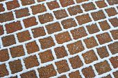 Snow On Red Brick Paving