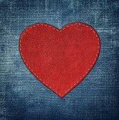 Red Leather Heart On Fabric In Grunge Style