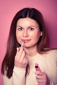 Woman Applying Lips Make Up