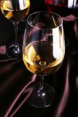White wine glass on cloth close-up