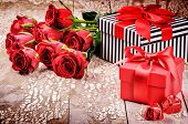Valentine's Setting With Bouquet Of Red Roses And Presents