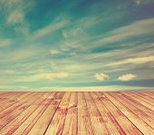 sunset sky and wood floor, background, retro film filtered, instagram style