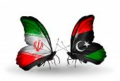 picture of libya  - Two butterflies with flags on wings as symbol of relations Iran and Libya - JPG
