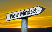 New Mindset sign with a sunset background
