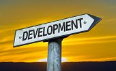 Development sign with a sunset background
