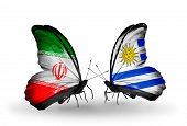 Two Butterflies With Flags On Wings As Symbol Of Relations Iran And Uruguay