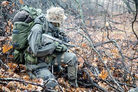 picture of raid  - Jagdkommando soldier Austrian special forces equipped with Steyr assault rifle during the raid  - JPG