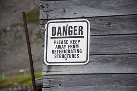 picture of hatcher  - Danger sign on building at Independence Mine - JPG