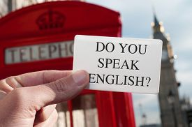 picture of text-box  - a man holding a signboard with the text do you speak english - JPG