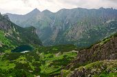 pic of emerald  - Picturesque view stretches over emerald pond and mountain ridge in Tatras Slovakia - JPG