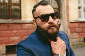 picture of long beard  - portrait of a casual young man with a long beard looking into the camera - JPG