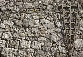 foto of fortified wall  - part of a stone wall with gardening element - JPG