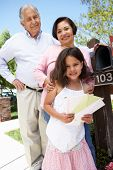 pic of granddaughter  - Hispanic Grandparents And Granddaughter Checking Mailbox - JPG