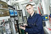 stock photo of engineer  - repairman engineer or inspector of fire engineering system or heating system with valve equipment in a boiler house - JPG