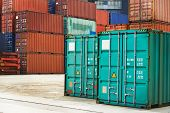 foto of dock  - Stack of freight container boxes after sorting in warehouse dock terminal of cargo sea port - JPG