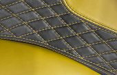picture of stitches  - black and yellow stitching leather in a car - JPG