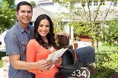 foto of mailbox  - Hispanic Couple Checking Mailbox - JPG