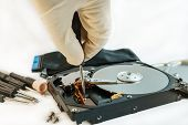 image of hard-on  - screw hard disk drive to repair for recovery information data storage - JPG