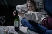 stock photo of alcohol abuse  - Young female alcoholic lying on the sofa - JPG