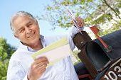 pic of mailbox  - Senior Hispanic Man Checking Mailbox - JPG