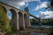 picture of suspension  - A view of the historic Menai suspension bridge spanning the Menai Straits Gwynnedd Wales UK - JPG