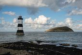 picture of anglesey  - Penmon lighthouse and Puffin Island in Anglesey Wales UK - JPG