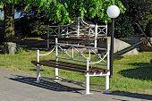 foto of pews  - Modern white metal Park bench close up - JPG