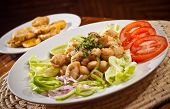 stock photo of plantain  - Delicious breaded calamari served with plantain chips - JPG