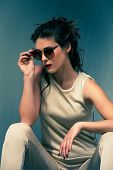 image of overalls  - elegant summer fashion young woman wearing sunglasses and golden overalls - JPG