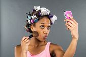 image of african american hair styles  - An African American woman putting on makeup - JPG