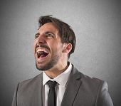 stock photo of scream  - Desperate businessman stressed out from work screams - JPG