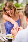 picture of propose  - Man making proposal with the ring to his girlfriend at the restaurant - JPG