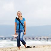 foto of barefoot  - Young smiling blonde woman barefoot in blue t - JPG